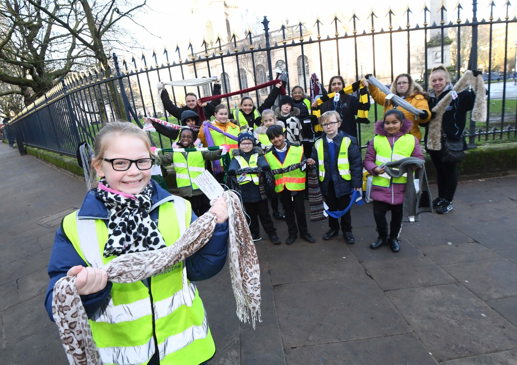 Pupils from Oasis Academy Short Heath hand out scarves to city's homeless and attach messages